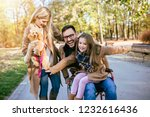 disabled father in wheelchair... | Shutterstock . vector #1232616436