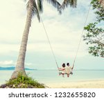 young couple swinging on a... | Shutterstock . vector #1232655820