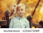 Boy And Owl.  Image With...