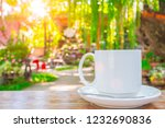 coffee cup on wooden table... | Shutterstock . vector #1232690836