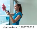 a young housewife in a blue t... | Shutterstock . vector #1232703313