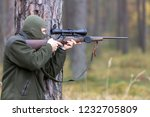 a person in the woods dressed... | Shutterstock . vector #1232705809