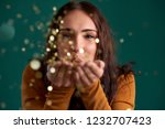 young woman blowing confetti... | Shutterstock . vector #1232707423