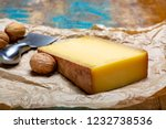 Piece of aged Comte or Gruyere de Comte, AOC French cheese made from unpasteurized cow
