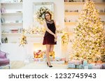 beautiful brown haired woman in ...   Shutterstock . vector #1232745943