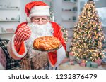 fresh and tasty pie is in hands ... | Shutterstock . vector #1232876479