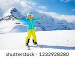 child skiing in the mountains.... | Shutterstock . vector #1232928280