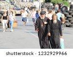ukrainian priests are walking... | Shutterstock . vector #1232929966