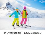 child skiing in the mountains.... | Shutterstock . vector #1232930080