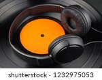 vinyl record and headphones on... | Shutterstock . vector #1232975053