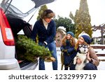 father brought christmas tree... | Shutterstock . vector #1232999719