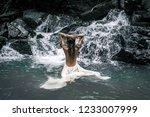 rear view of beautiful woman in ... | Shutterstock . vector #1233007999