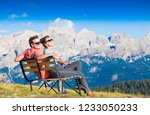 hikers with backpacks sitting... | Shutterstock . vector #1233050233