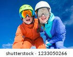 a couple on mountain vacation.... | Shutterstock . vector #1233050266