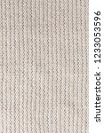 white knitted fabric close up.... | Shutterstock . vector #1233053596