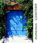 blue wooden gate  | Shutterstock . vector #1233070309