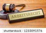 a gavel and a name plate with... | Shutterstock . vector #1233091576