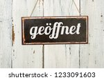 old metal sign in front of a... | Shutterstock . vector #1233091603