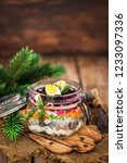 Stock photo traditional russian layered betroot and herring salad under a fur coat in glass jar rustic 1233097336