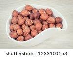 hazelnuts in white bowl as... | Shutterstock . vector #1233100153