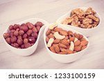 healthy different nuts and... | Shutterstock . vector #1233100159