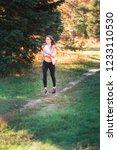 beautiful young sportive woman...   Shutterstock . vector #1233110530