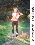 beautiful young sportive woman...   Shutterstock . vector #1233110533