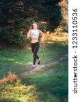 beautiful young sportive woman...   Shutterstock . vector #1233110536