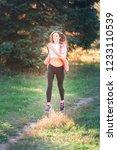 beautiful young sportive woman...   Shutterstock . vector #1233110539