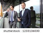 business people having coffee... | Shutterstock . vector #1233136030