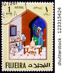 Small photo of FUJAIRAH - CIRCA 1967: A stamp printed in Fujairah shows the image of a man in the room of jars from the story of Ali Baba , circa 1967.