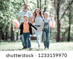 cheerful family spends time in... | Shutterstock . vector #1233159970