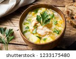 fish soup in a wooden bowl with ... | Shutterstock . vector #1233175480