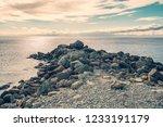 stone breakwater at sea coast... | Shutterstock . vector #1233191179