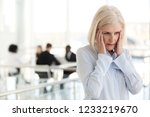 stressed fatigued mature... | Shutterstock . vector #1233219670