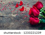 Stock photo red roses flowers with red hearts on old wooden background with place for text romantic valentines 1233221239