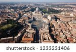 Small photo of Aerial drone view of Saint Peter's square in front of world's largest church - Papal Basilica of St. Peter's, Vatican - an elliptical esplanade created in the mid seventeenth century, Rome, Italy