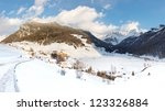 The idyllic village of Rein in Taufers in the Alps, South Tyrol, Italy, on a sunny winter day. - stock photo