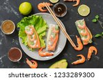 spring rolls with shrimps on a... | Shutterstock . vector #1233289300