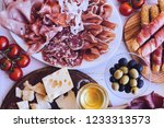 table full of mediterranean... | Shutterstock . vector #1233313573