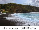 sea waves hitting a beach with... | Shutterstock . vector #1233325756