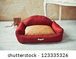Stock photo red pet bed with white sofa in provance style in home interior 123335326