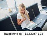 woman waiting his flight at... | Shutterstock . vector #1233364123