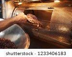closeup of a worker in an... | Shutterstock . vector #1233406183