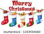 christmas socks full of gifts... | Shutterstock .eps vector #1233434683