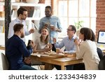 multiracial happy work team... | Shutterstock . vector #1233434839
