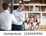 middle aged happy smiling boss  ... | Shutterstock . vector #1233434950
