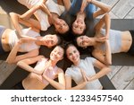 six diverse funny girls lying... | Shutterstock . vector #1233457540