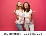 two exited woman having fun and ...   Shutterstock . vector #1233467206