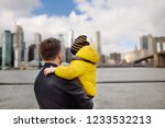 father and his little son... | Shutterstock . vector #1233532213